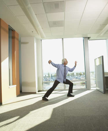 tai chi: Businessman doing Tai Chi in the office
