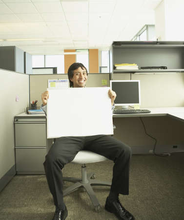 dry erase: Hispanic businessman holding a blank dry erase board in his lap, Redwood City, California, United States LANG_EVOIMAGES