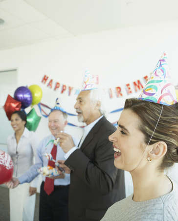 office space: Group of coworkers at a retirement party, Redwood City, California, United States LANG_EVOIMAGES