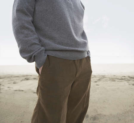 Man standing on the beach with his hands in his pockets, Ocean Beach, San Francisco, United States Stock Photo - 16090573