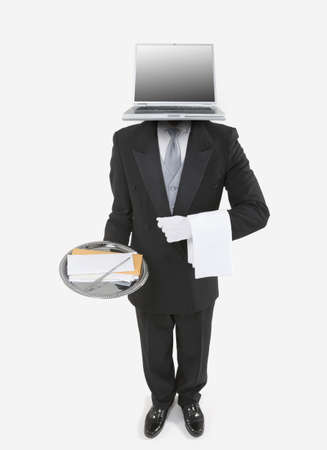 Butler with a laptop for a head holding a silver tray with mail Stock Photo - 16090584