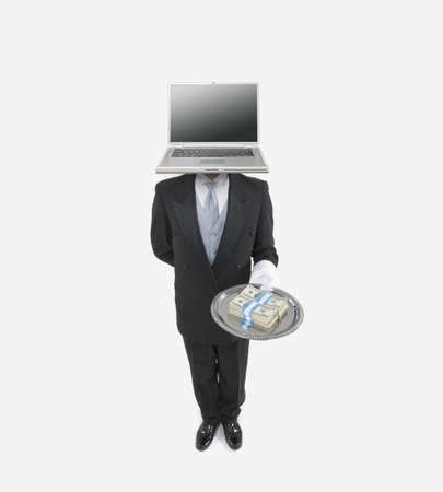 Butler with a laptop for a head holding a silver tray with bundles of money Stock Photo - 16090585