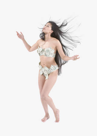 Young Asian woman wearing underwear made out of money Stock Photo - 16090588