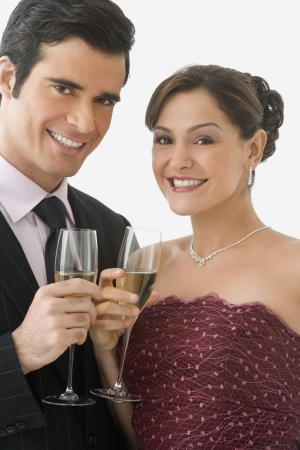 Studio shot of couple smiling and holding champagne glasses Stock Photo - 16090678