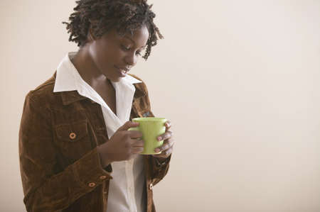 america's cup america: Young African woman with mug of coffee