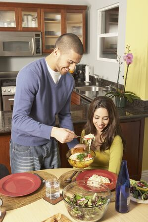 dinning: Young Hispanic couple at the dinner table, San Rafael, California, United States LANG_EVOIMAGES