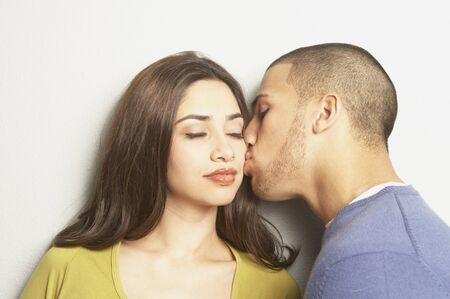 Young Hispanic couple kissing, San Rafael, California, United States Stock Photo