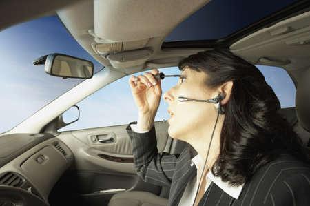 san rafael: Businesswoman driving and putting on makeup, San Rafael, California, United States