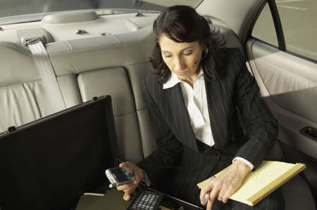 phone business: Businesswoman working in the backseat of a car, San Rafael, California, United States