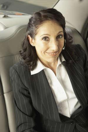 san rafael: Businesswoman n the backseat of a car, San Rafael, California, United States LANG_EVOIMAGES