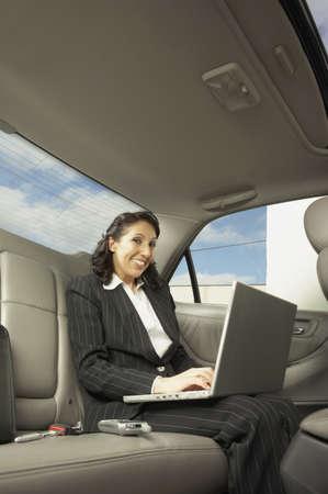 san rafael: Businesswoman working in the backseat of a car, San Rafael, California, United States