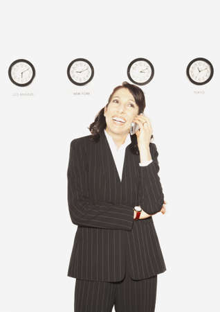 Businesswoman in front of clocks with different time zones, San Rafael, California, United States Stock Photo - 16090741