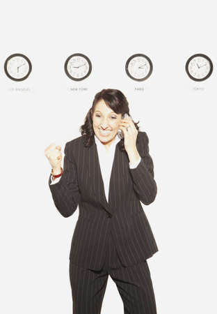 acknowledging: Businesswoman in front of clocks with different time zones, San Rafael, California, United States LANG_EVOIMAGES