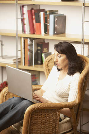 Woman sitting with laptop, San Rafael, California, United States Stock Photo - 16090743