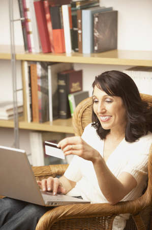 Woman making online purchase, San Rafael, California, United States Stock Photo - 16090744