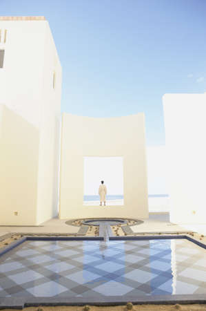 longshot: Person in robe at beach resort, Los Cabos, Mexico