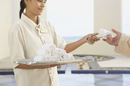 Hotel employee giving out a hot towel, Los Cabos, Mexico Stock Photo - 16090750