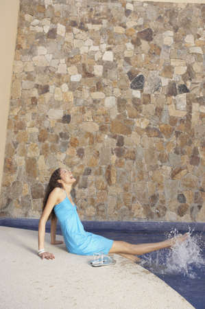 los cabos: Woman kicking her feet in hotel pool, Los Cabos, Mexico