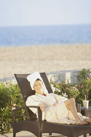 Woman in lounge chair at beach hotel, Los Cabos, Mexico Stock Photo - 16090775