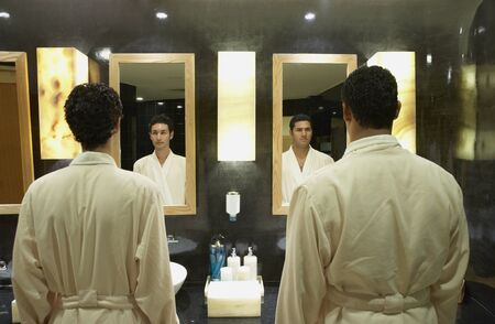 Two men in robes in front of bathroom mirrors, Los Cabos, Mexico Stock Photo - 16090784