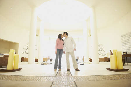 Couple kissing in hotel lobby, Los Cabos, Mexico Stock Photo - 16090802
