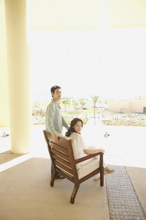 Couple on patio at hotel, Los Cabos, Mexico