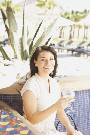 Hispanic woman with drink at hotel bar, Los Cabos, Mexico Stock Photo - 16090810