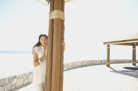 midsummer pole: Hispanic woman outdoors at beach resort, Los Cabos, Mexico