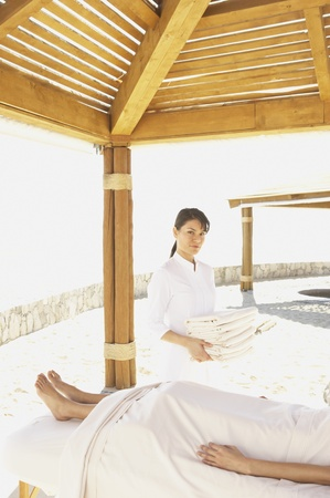 Female massage therapist with client outdoors, Los Cabos, Mexico Stok Fotoğraf