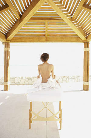 Woman sitting up on massage table outdoors, Los Cabos, Mexico Stock Photo - 16090822