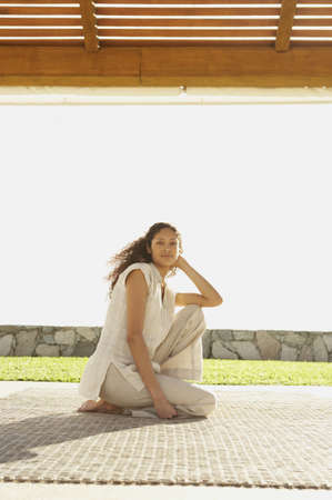 Hispanic woman sitting outdoors, Los Cabos, Mexico Stock Photo - 16090824