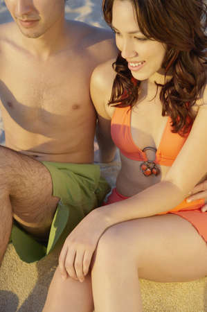 Close up of couple sitting on beach, Los Cabos, Mexico Stock Photo - 16090827