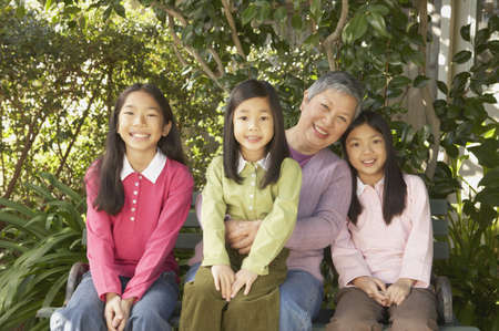 gramma: Asian grandmother with granddaughters outdoors, San Rafael, California, United States