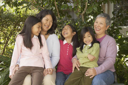 gramma: Three generations of female Asian family members smiling outdoors, San Rafael, California, United States LANG_EVOIMAGES
