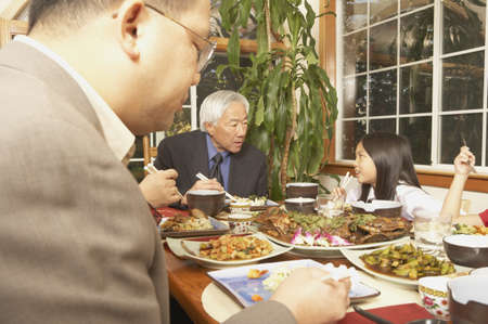 poppa: Asian family eating at the dinner table, San Rafael, California, United States