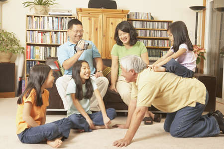 Three generations of an Asian family playing in the livingroom, San Rafael, California, United States Stock Photo - 16090892