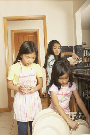 3 persons only: Three young Asian sisters doing the dishes, San Rafael, California, United States
