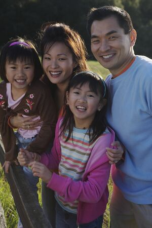 poppa: Asian family smiling in the countryside LANG_EVOIMAGES