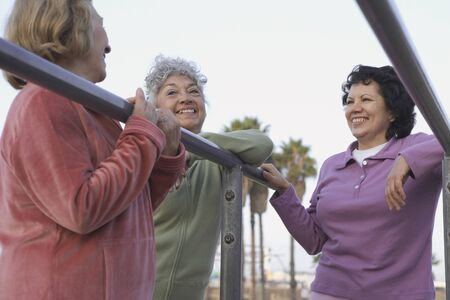 midsummer pole: Group of senior woman in sweatsuits talking LANG_EVOIMAGES