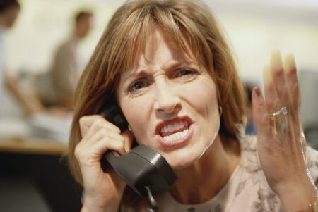 frustrating: Businesswoman yelling on telephone, Dallas, Texas, United States