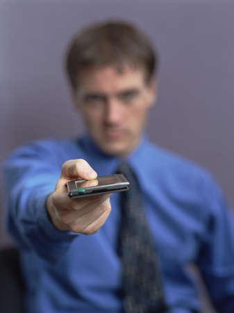 Businessman holding out electronic organizer, Dallas, Texas, United States Stock Photo - 16090960