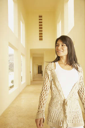 los cabos: Hispanic woman walking down sunlit hallway, Los Cabos, Mexico