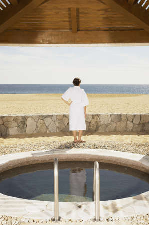 Woman in bathrobe outdoors at beach resort, Los Cabos, Mexico Stock Photo - 16090966
