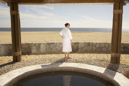 Woman in bathrobe outdoors at beach resort, Los Cabos, Mexico Stock Photo - 16090967
