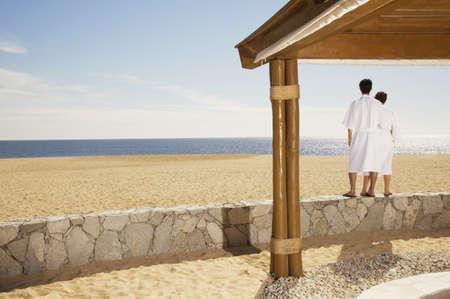 Couple in bathrobes at beach, Los Cabos, Mexico Stock Photo - 16090969