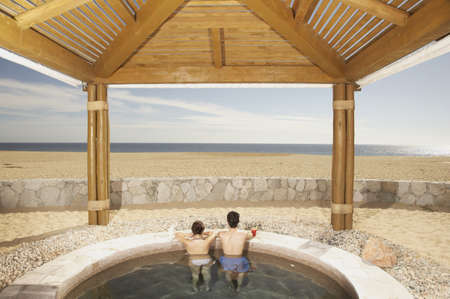 Couple in hot tub outdoors at beach resort, Los Cabos, Mexico Stock Photo - 16090971