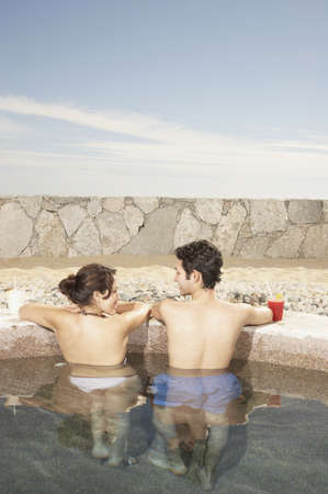 Couple in hot tub outdoors at beach resort, Los Cabos, Mexico Stock Photo - 16090972