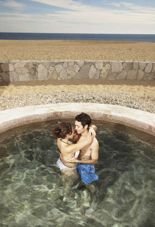 Couple hugging in hot tub outdoors at beach resort, Los Cabos, Mexico Stock Photo - 16090973