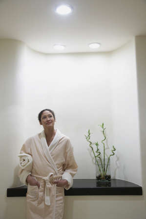 Woman in bathrobe standing in spa alcove, Los Cabos, Mexico Stock Photo - 16090975