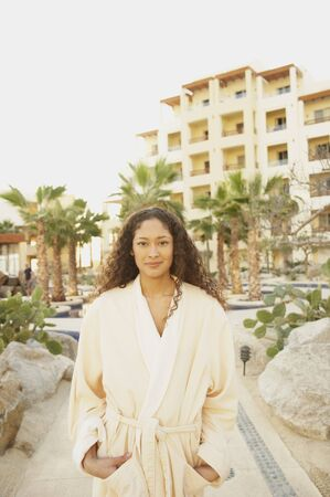 Hispanic woman in bathrobe outdoors at resort hotel, Los Cabos, Mexico Stock Photo - 16090997